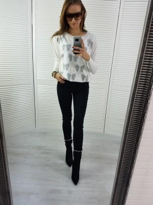 Sweterek biały kokardki